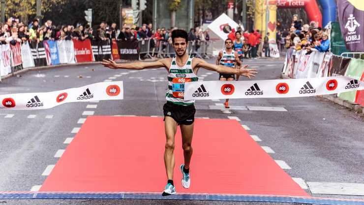 man running on black asphalt road